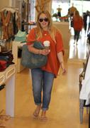 http://img219.imagevenue.com/loc615/th_099733474_Hilary_Duff_Out_Shopping_in_Beverly_Hills22_122_615lo.jpg